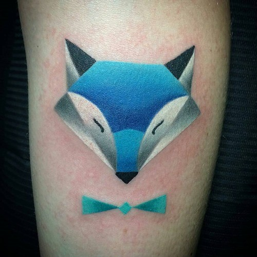 Triangle shaped original fairy tale fox with tiny blue ribbon bow tattoo