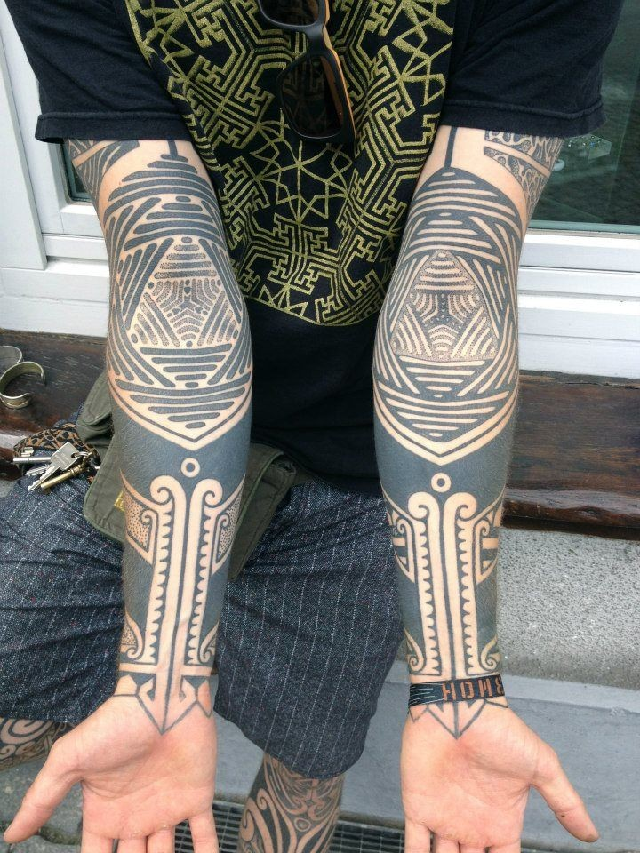 Tribal style big black and white ornaments sleeve tattoo
