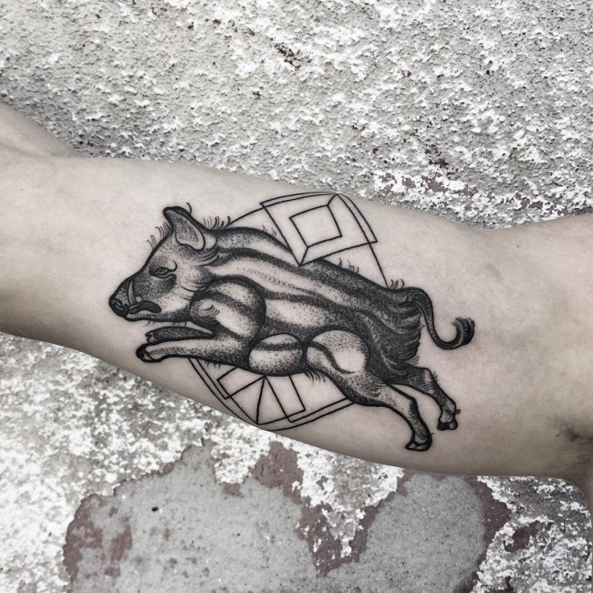 Tribal style black ink biceps tattoo with geometrical figures