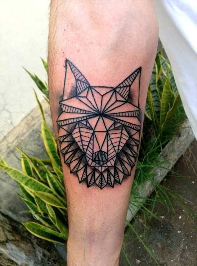 Tribal style homemade like black ink wolf head tattoo on forearm