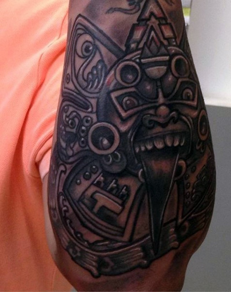 Tribal style ornaments tattoo on forearm