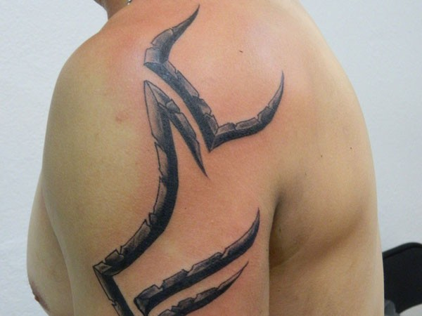 Tribal style simple painted black and white symbols tattoo on shoulder