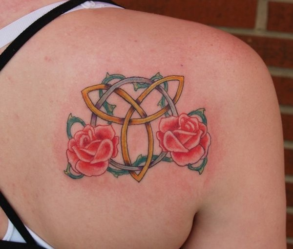 Trinity symbol with red roses tattoo on shoulder blade