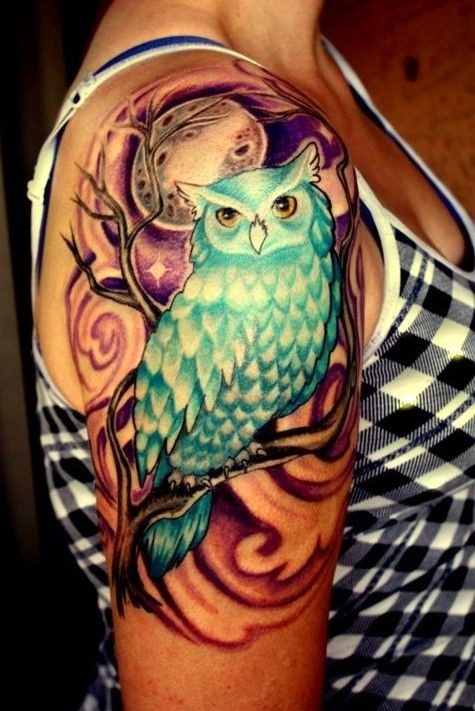 Turquoise owl on a tree in a full moon tattoo