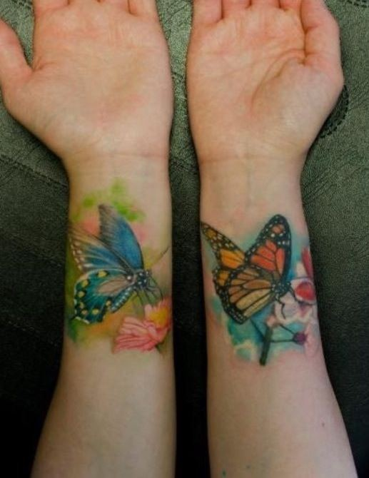 Two different butterfly wrist tattoos for lady