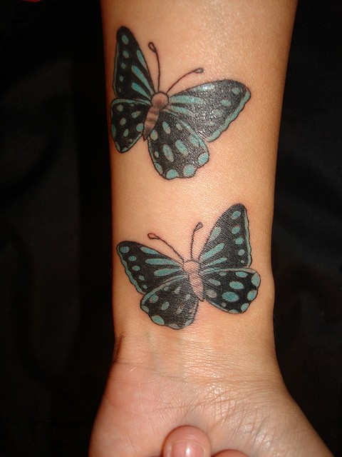 Two green butterfly wrist tattoos design
