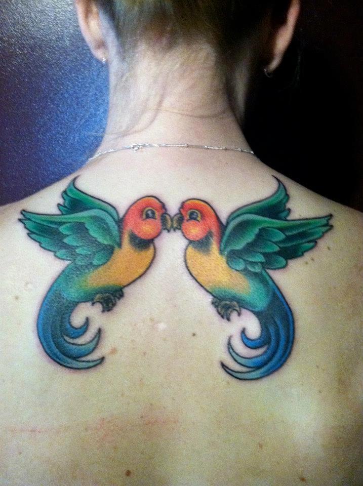 Two kissing symmetrical love bird tattoo