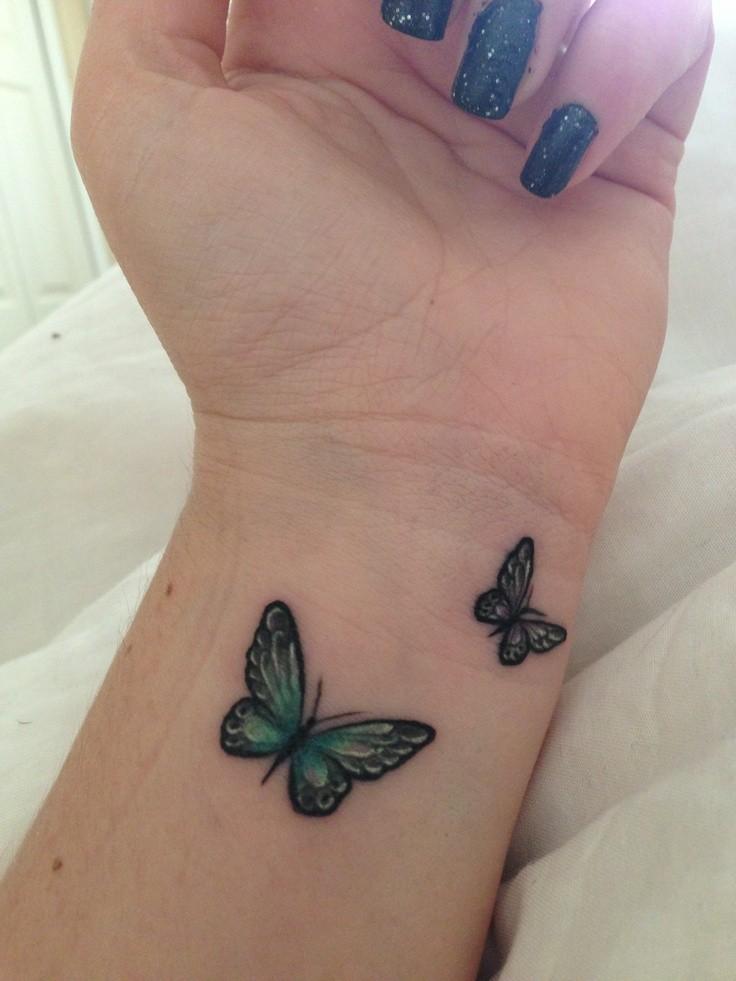 Simple butterfly tattoo on wrist