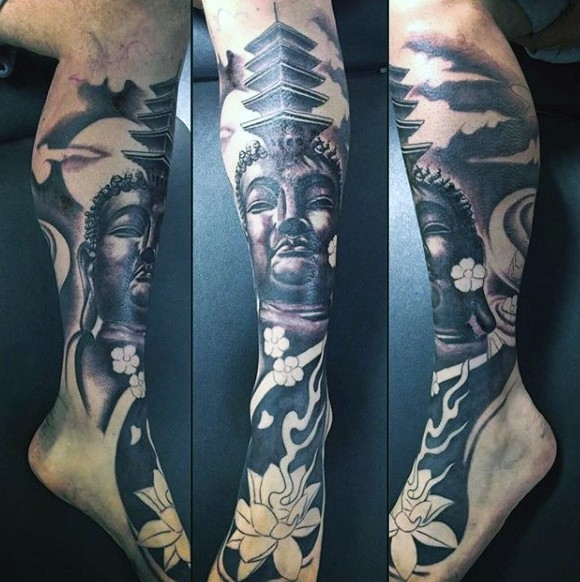 Typical black and gray style leg tattoo of Buddha statue with old temple and flower