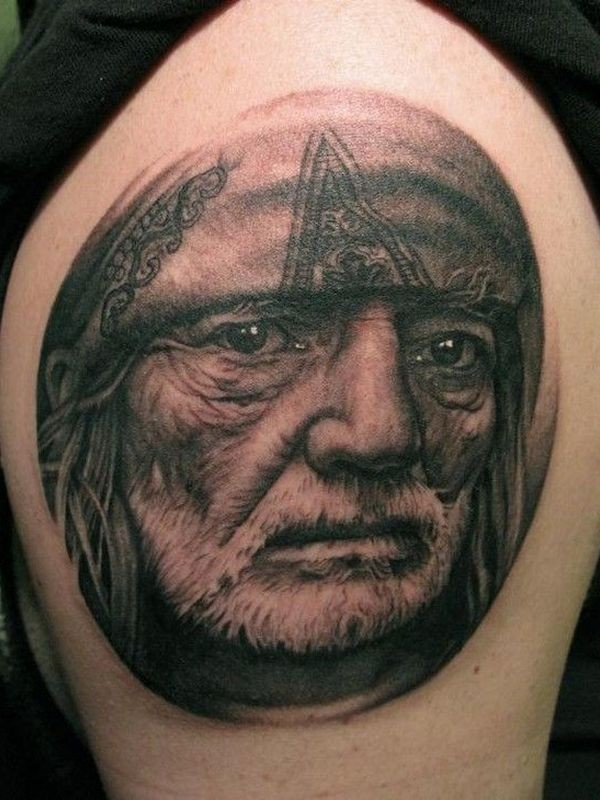 Typical black and gray style shoulder tattoo of men portrait