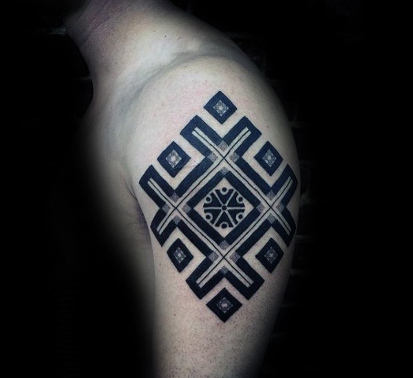 Typical black and white ornament tattoo on shoulder