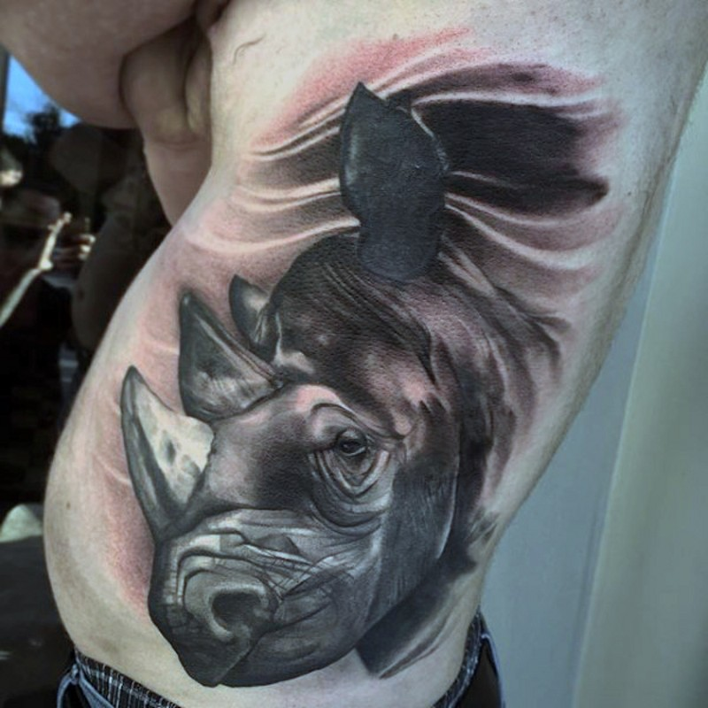 Typical black and white side tattoo of detailed rhino head
