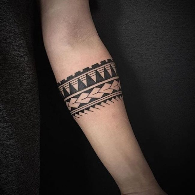 Typical black ink forearm tattoo of cute ornaments