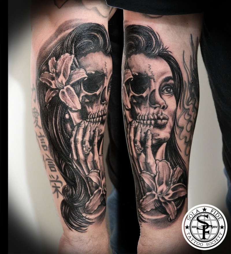 Typical Black Ink Forearm Tattoo Of Half Skull Half Woman Face