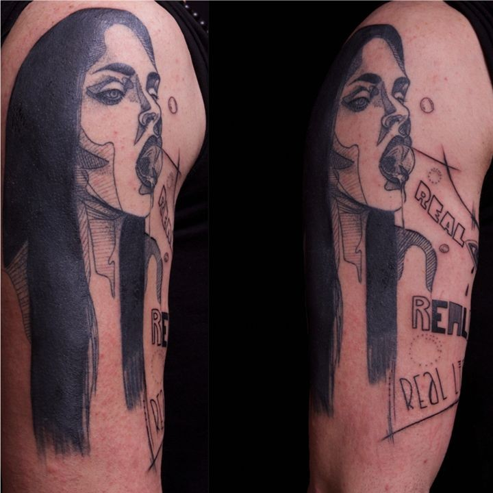 Typical black ink forearm tattoo of woman portrait with lettering