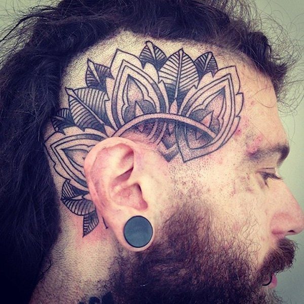 Typical black ink head tattoo of Hinduism ornament