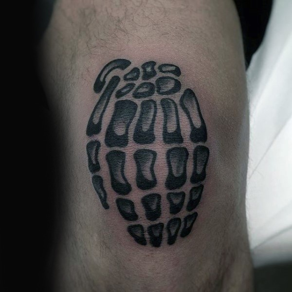 Typical black ink knee tattoo of skeleton hand