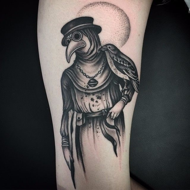 Typical black ink plague doctor tattoo on arm