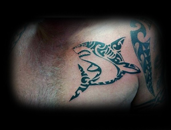 Typical black ink Polynesian style chest tattoo of evil shark