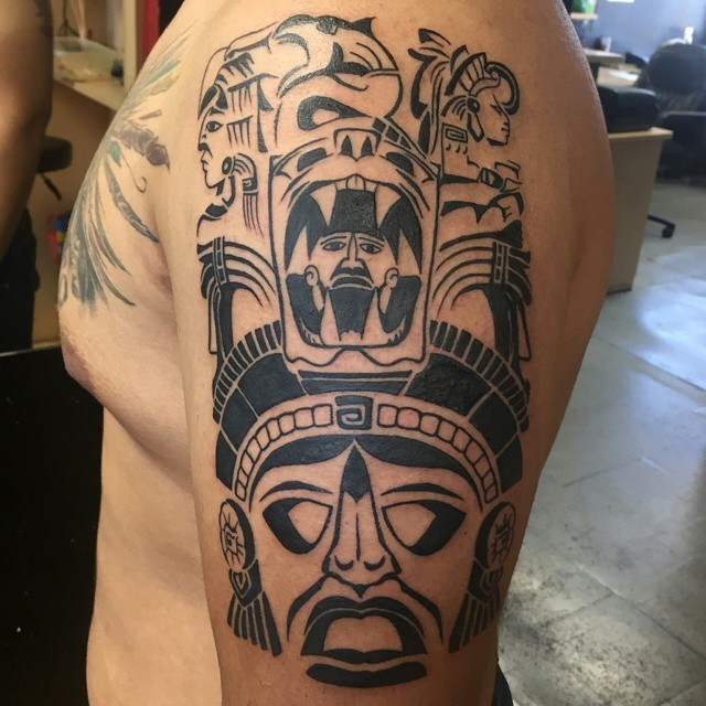 Typical black ink shoulder tattoo of ancient wall paintnigs