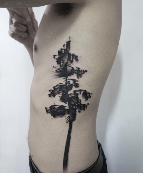 Typical black ink side tattoo of big tree