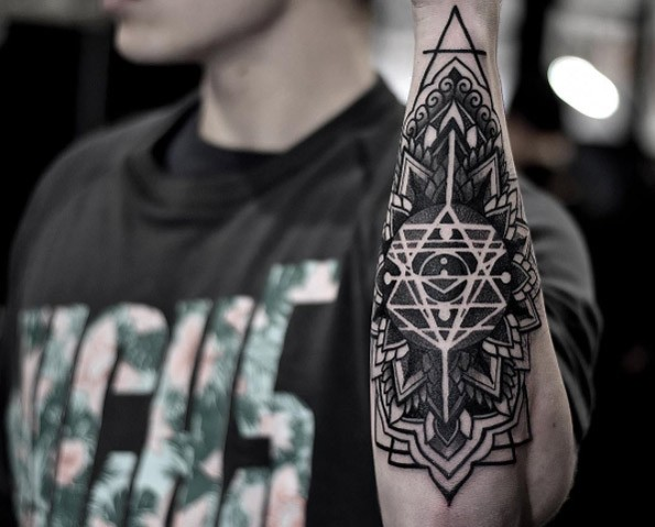 Typical blackwork style floral ornament tattoo combined with magical lines