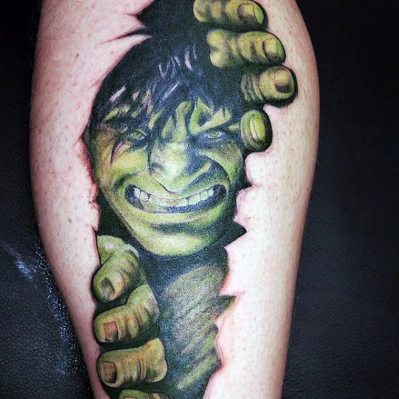 Typical colored and designed under skin Hulk tattoo on leg muscle