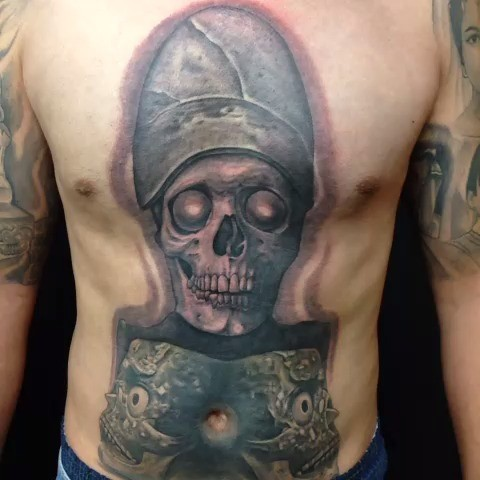 Typical colored chest and belly tattoo of skeleton with hat