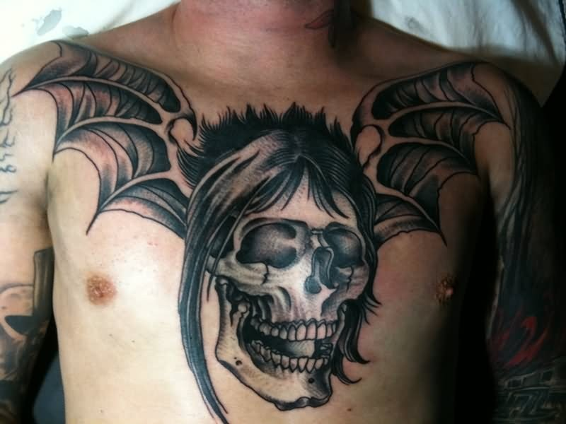 Typical colored chest tattoo of demonic skull with demonic wings