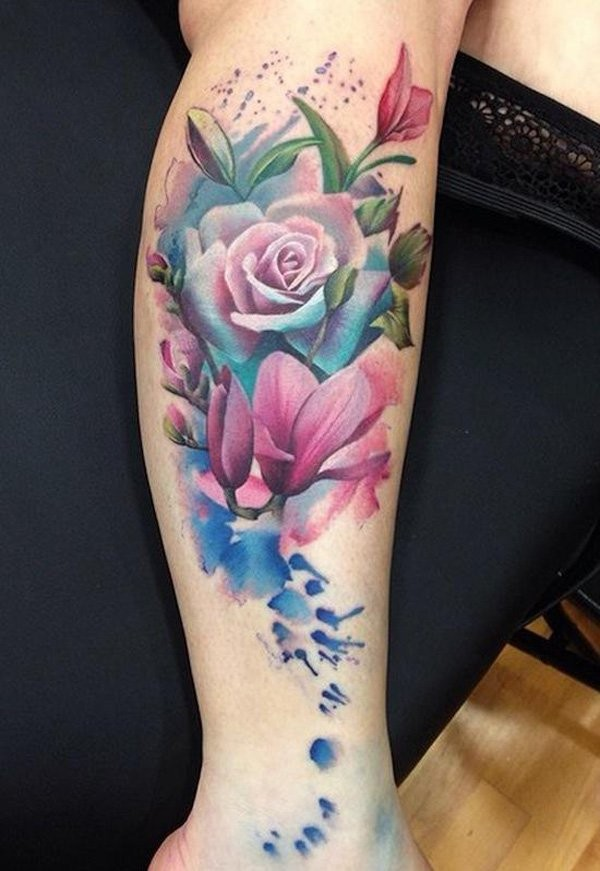 Typical colored leg tattoo of beautiful flowers