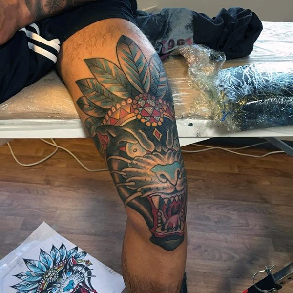 Typical colored leg tattoo of big evil demon dog