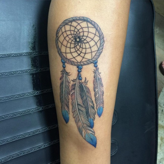 Typical colored tattoo of dream catcher with feather