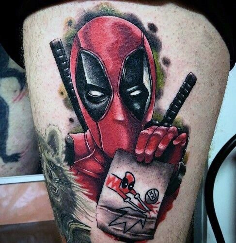 Typical colored thigh tattoo of evil Deadpool with cute card