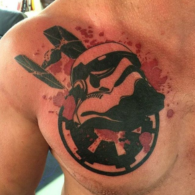 Typical designed and colored chest tattoo of Storm trooper with star wars star fighter