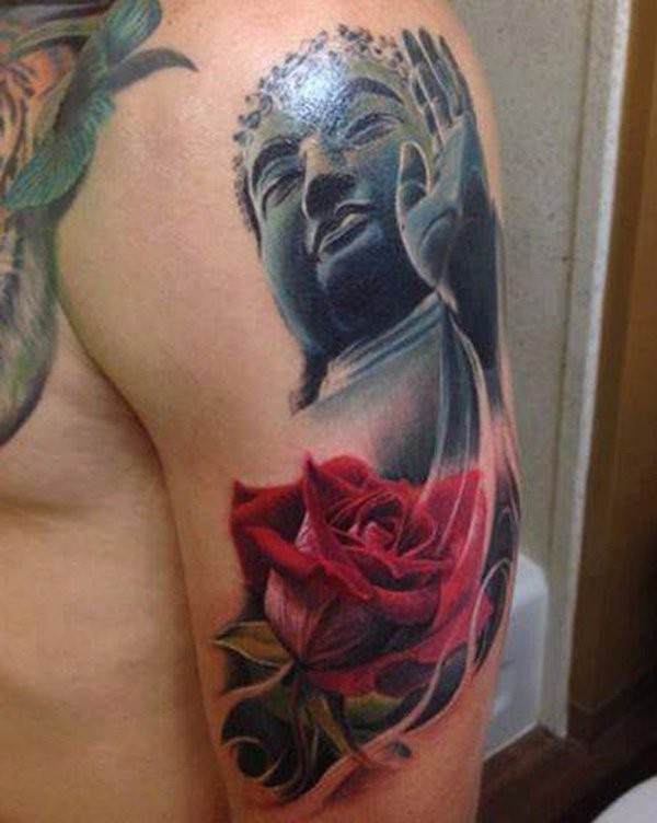 Typical designed and colored shoulder tattoo of stone Buddha statue and rose flower