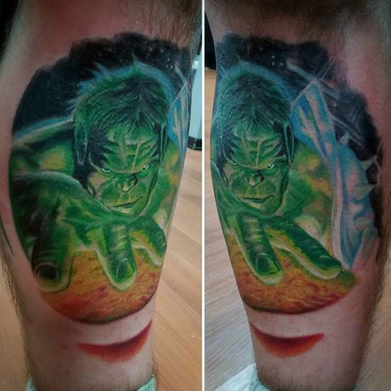 Typical designed comic books style colored fantasy Hulk tattoo on leg muscle