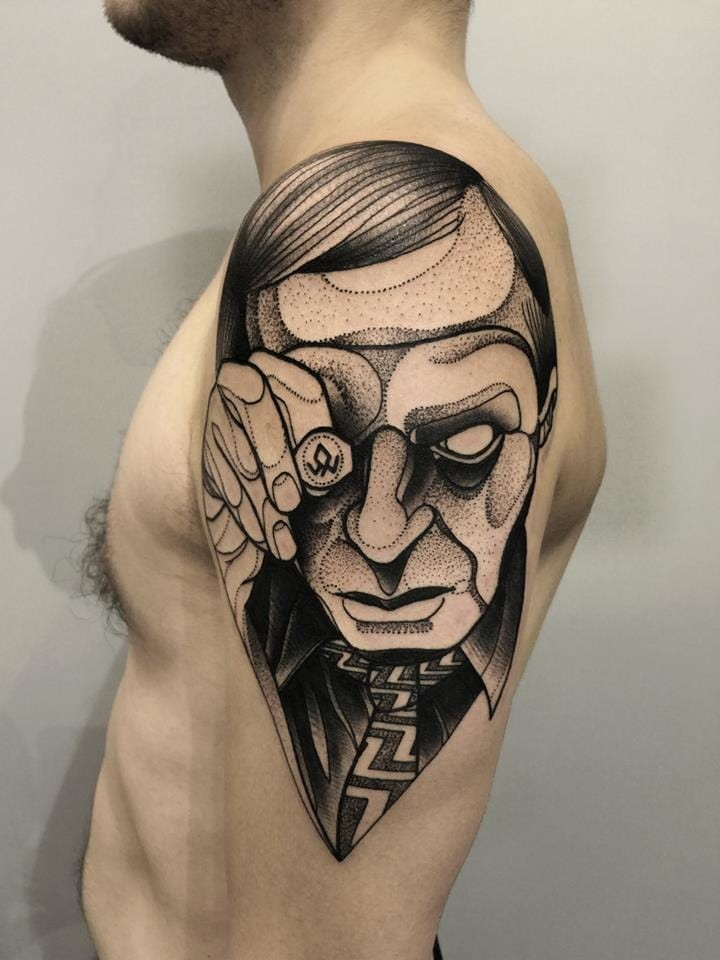 Typical dotwork style painted by Michele Zingales upper arm tattoo of creepy man with ring