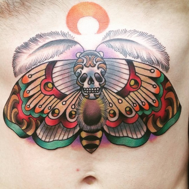Typical illustrative style belly tattoo of big butterfly