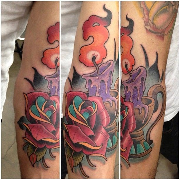 Typical illustrative style colored burning candle tattoo with rose
