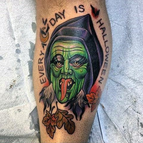 Typical illustrative style colored leg tattoo of creepy witch with lettering and leaves
