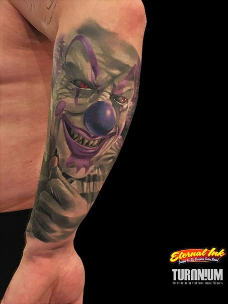Typical illustrative style hand tattoo of evil clown