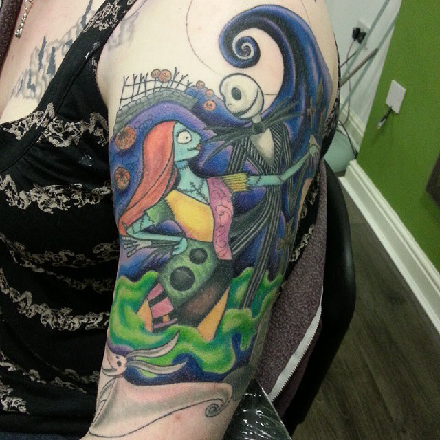 Typical illustrative style shoulder tattoo of Nightmare before Christmas couple with small dog like ghost