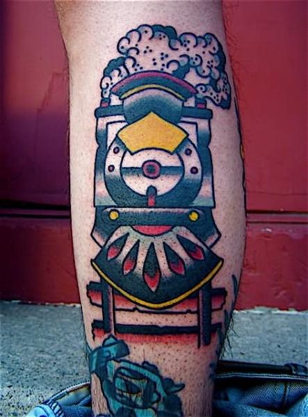 Typical multicolored train tattoo on leg