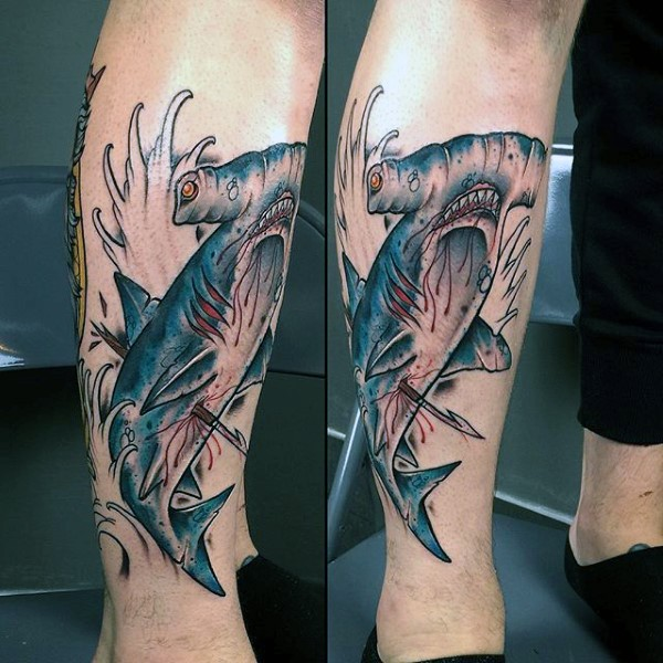 Typical new school style colored leg tattoo of harpooned hammerhead shark and waves