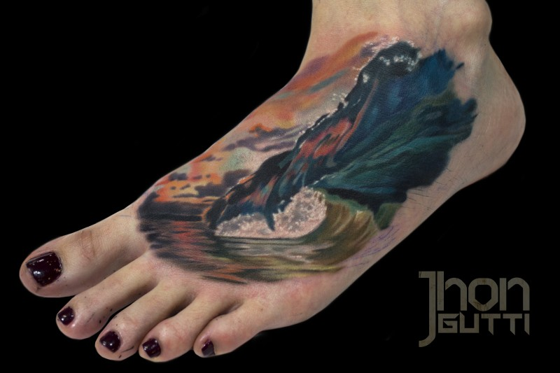 Typical nice painted and colored foot tattoo of big wave