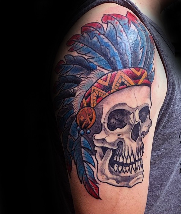 Typical old school style colored big shoulder tattoo of Indian skull with feather