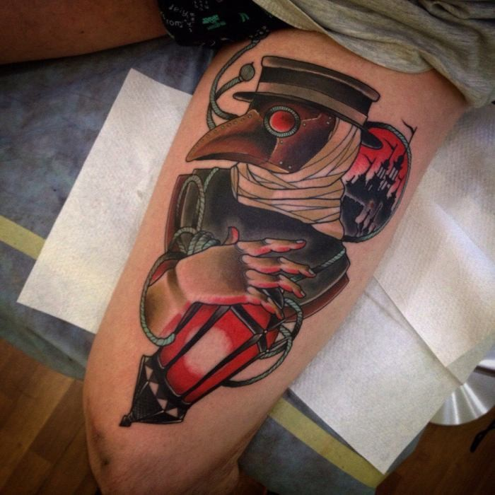 Typical old school style colored tattoo of plague doctor on thigh