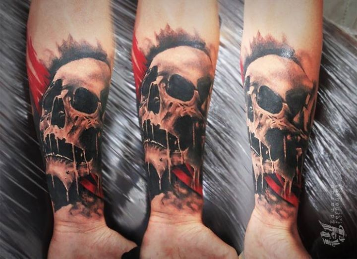 Typical realistic looking colored forearm tattoo of human skull