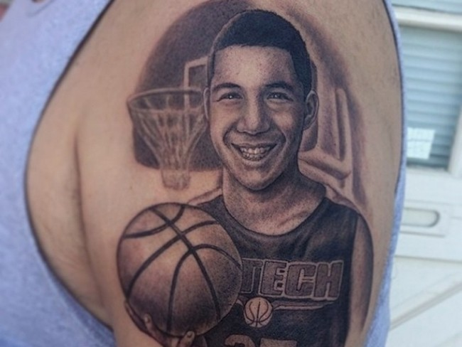 Typical realistic looking shoulder tattoo of young basketball player