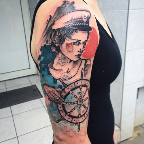 Typical sketch style colored shoulder tattoo of sailor woman with ships steering wheel